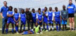 photo of genesis soccer team and volunteers