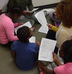 photo of genesis youth foundation arts programming volunteers working with children