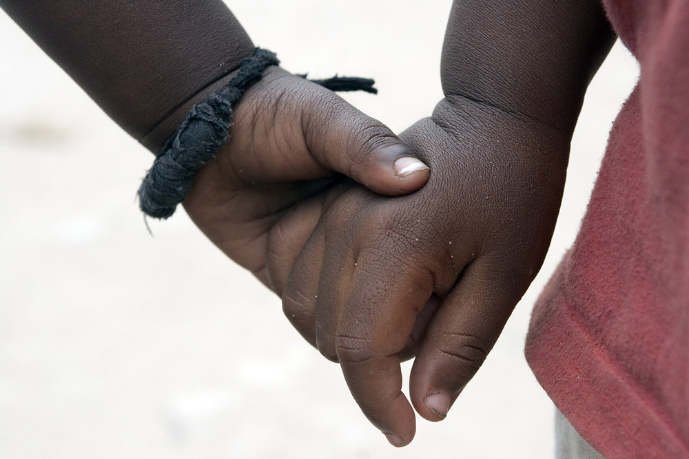 orphans holding hands