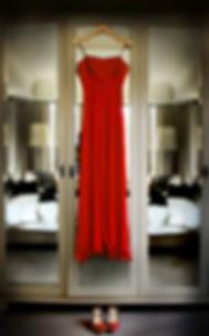 the Brides Red Wedding Dress hanging prir to her wedding in Daylesford
