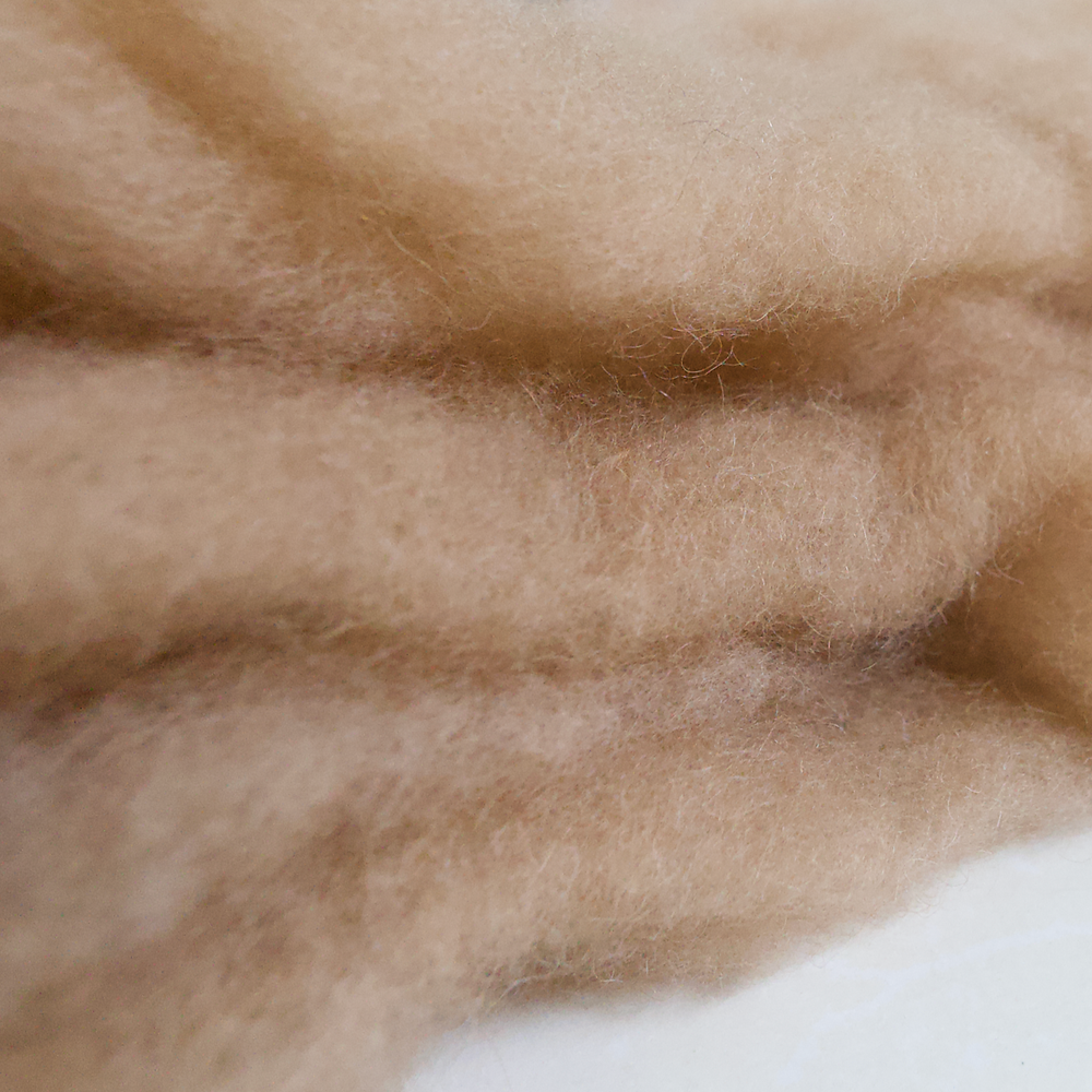 Camel hair being manually separated