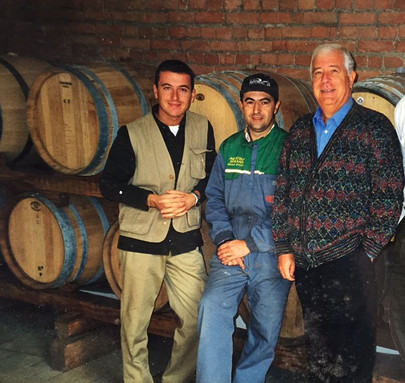 a young me with my dad and one of my best friends/winemaker
