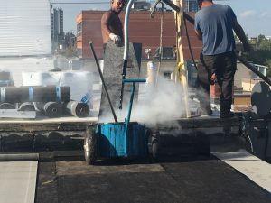 pumping-hot-tar-300x225.jpg