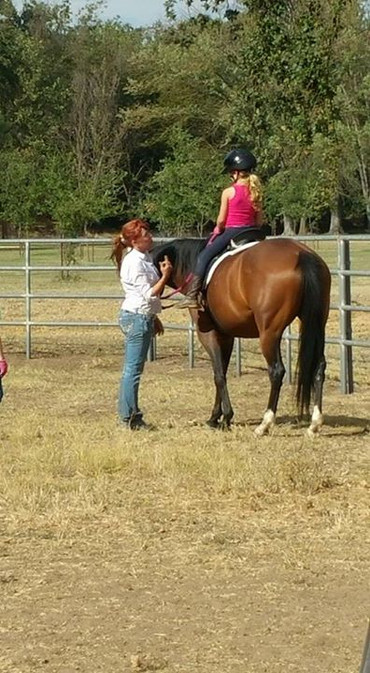 Anna riding Roxie