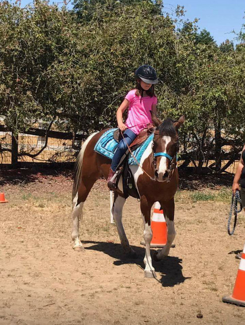 Julia riding Rain
