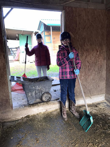 Natalia and Molly cleaning up