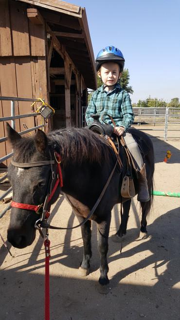 Colt riding Mime