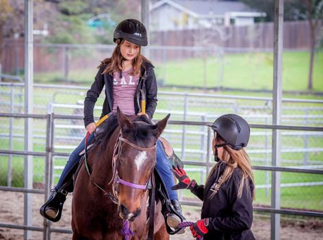 Ava riding Roxie
