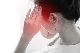 Young woman having strong headache and t