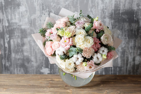 beautiful bouquet of mixed flowers into