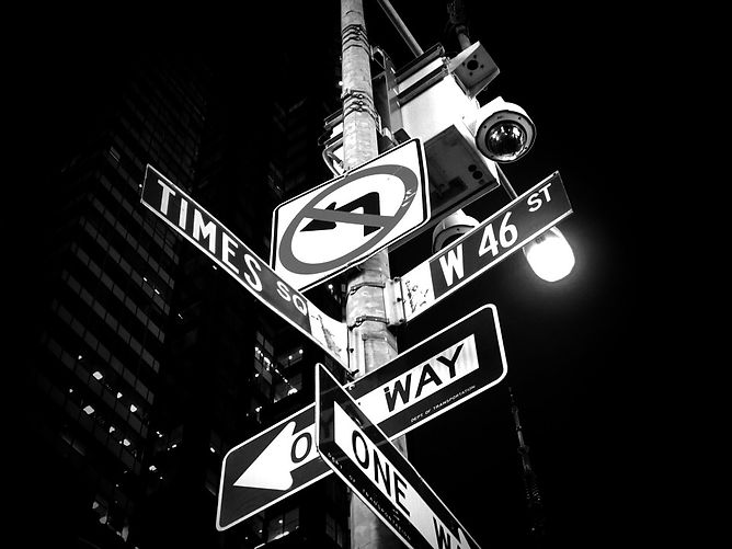 Multi directional signage from New York city (no left turn, one way, Times Square, West 46th street)
