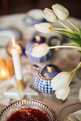 bouquet-of-white-flowers-on-table-set-fo