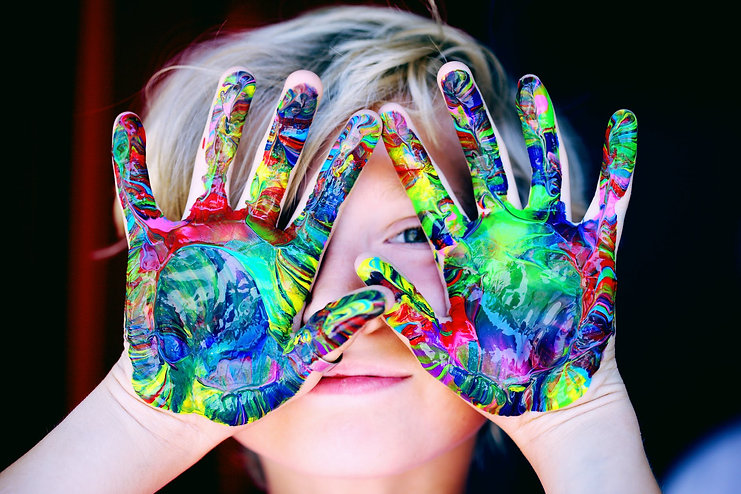 A child with paint covered hands