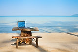 office on the beach, computer and table.