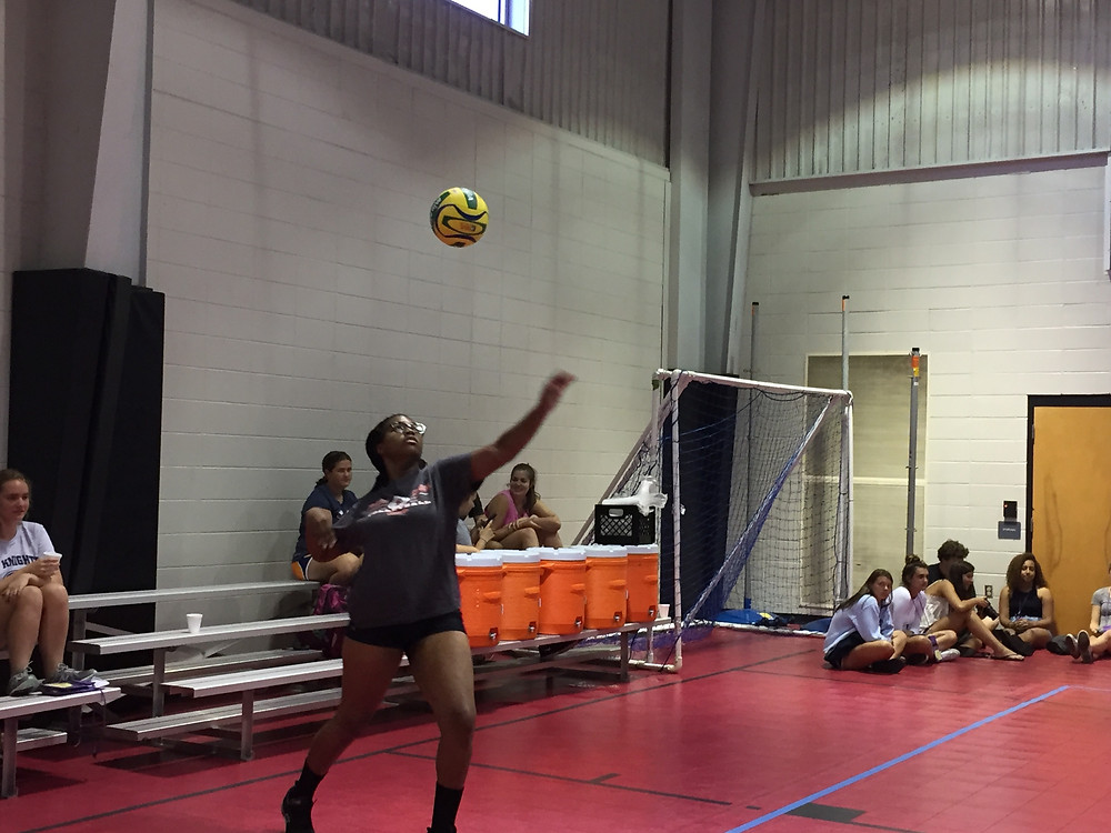 Taylor serves the ball during ludi volleyball.