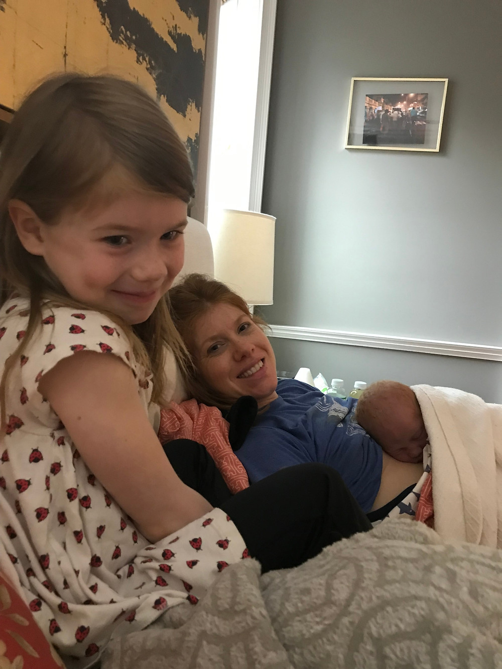 Six-year-old Julia meeting her baby brother.