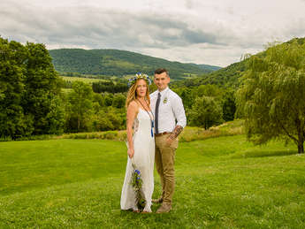 Bride and groom with mountains in the Catskills