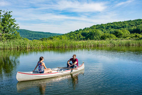 Attractive couple in a canoe in the Catskill Mountains