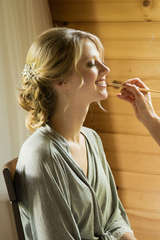 Bride getting makeup done at The ponds at Natural Gardens in East Meredith New York