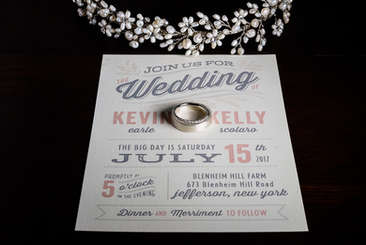 Wedding invitation and rings at Blenheim Hill Farm in Jefferson New York