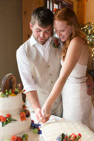 Bride and Groom cutting the wedding cake in Oneonta New York