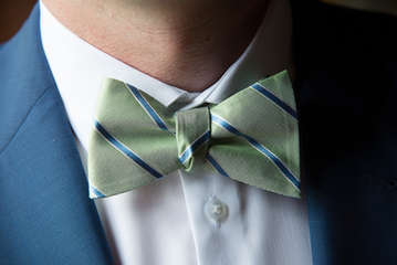 Closeup of a grooms bowtie on wedding day