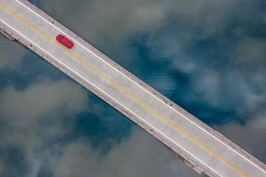 Ariel view of a red car crossing the Shavertown Bridge in Andes New York
