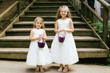 Flower girls in front of a wood staircase in Bovina New York