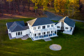Aerial view of a white mansion in The Catskills