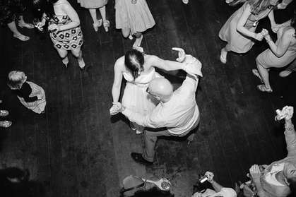 Birds eye view of a bride and dad dancing