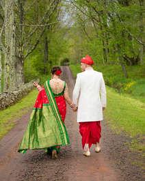 Indian wedding couple walking down a path at The Stone Tavern Farm in Roxbury New York