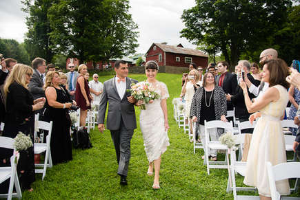 Bride walking down the aisle with father at the Benheim Hill Farm in the Catskills