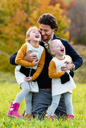 Father playing with daughters  with autum colors in Andes New York