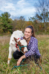 Farm girl in a field with her pet calf in The Catskills