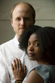 African American woman and man in front of a neutral wall in Andes New York
