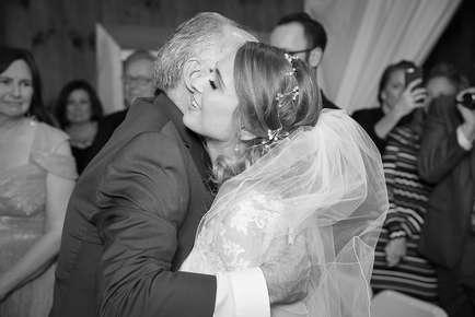 Dad hugging his daughter at the Full Moon Resort in The Catskills