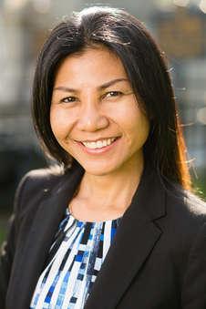 Headshot of an Asian woman outside in Delhi New York