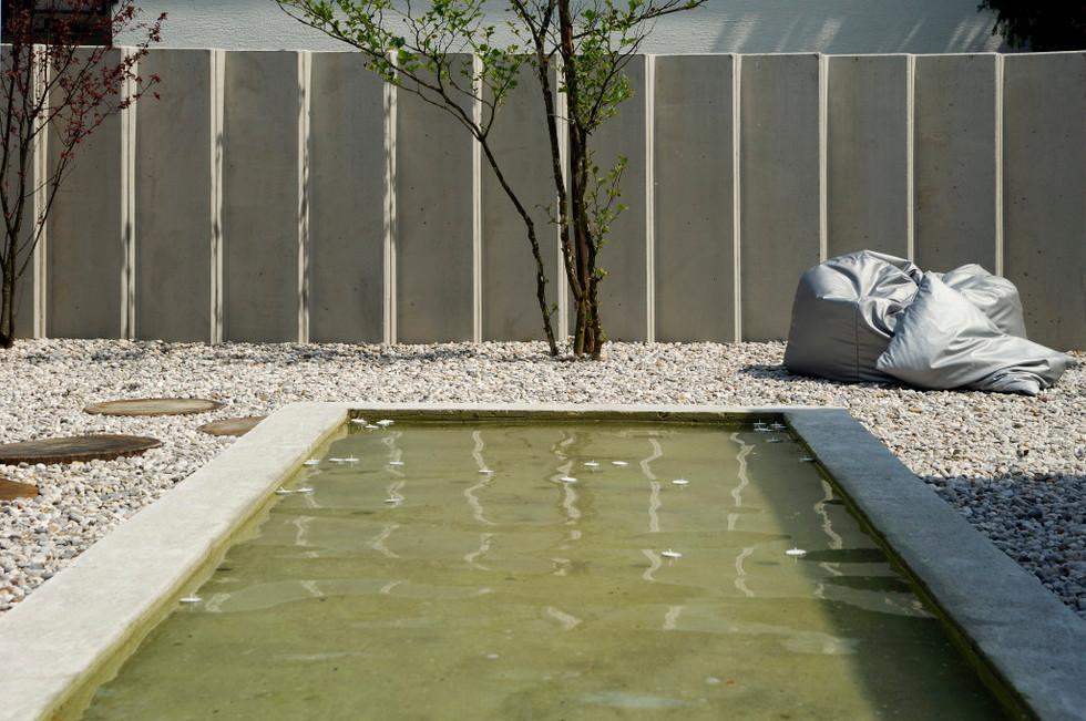 studio db ai atrium water garden reflecting pool