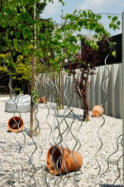 studio db ai atrium garden terracotta light design