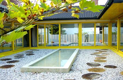 studio db ai luxury house atrium water pebble atrium with water mirror