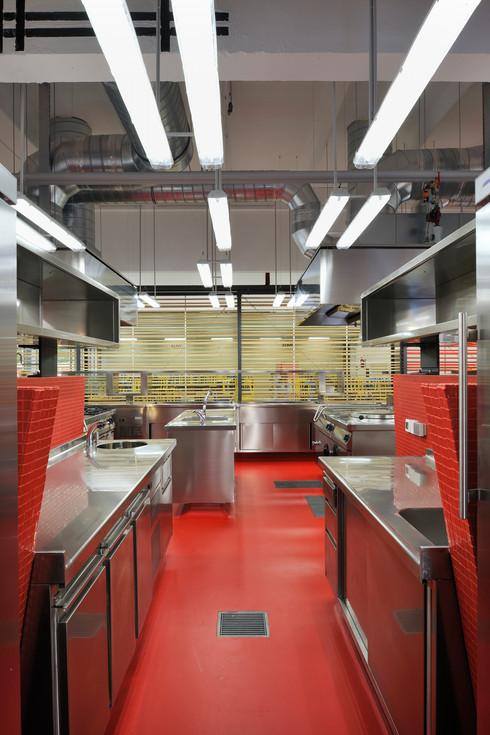 studio db ai School kitchen architecture public kitchen design red mosaic