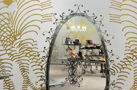 studio db ai art deco fashion boutique big oval mirror design