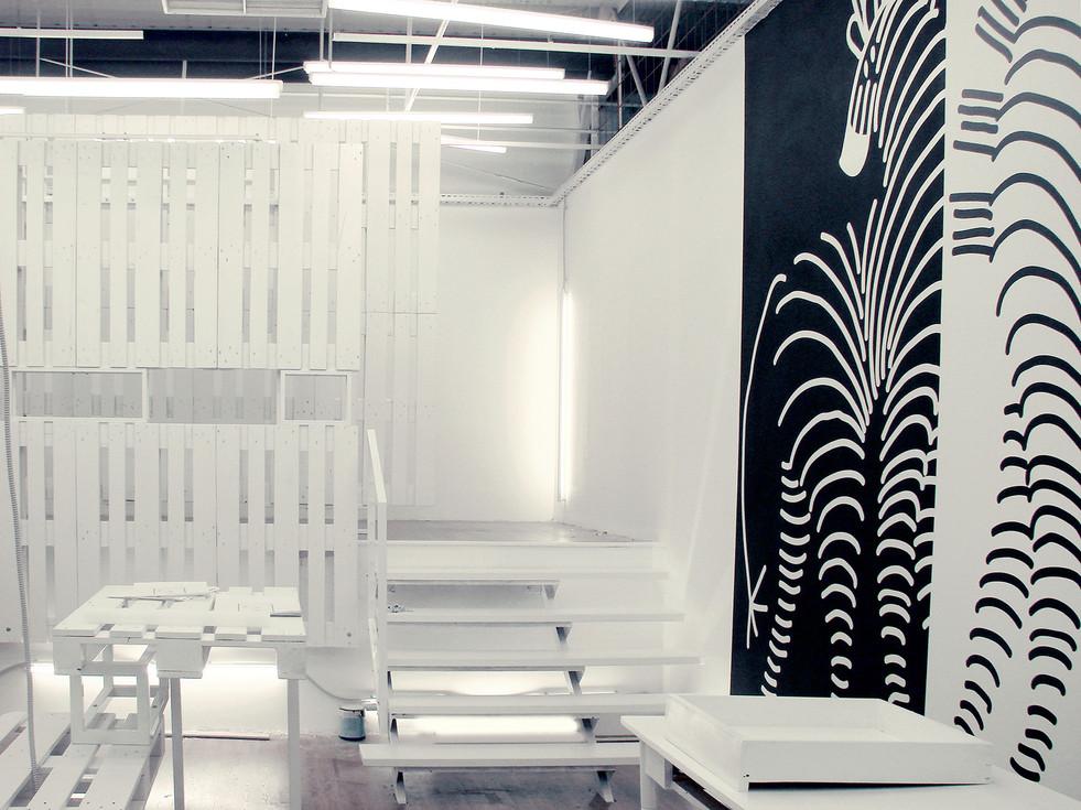 studio db ai industrial fashion pop-up store pallet retail design