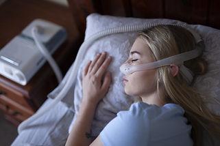 CPAP_Woman_Sleeping.jpeg