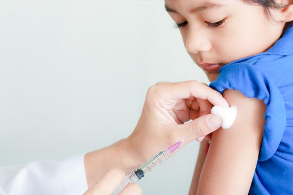 Child getting immunization booster shot