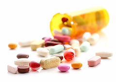 Vitamins and medications scattered