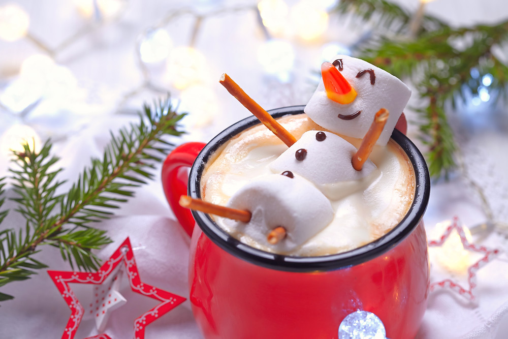 Marshmellow snowman floating in cup