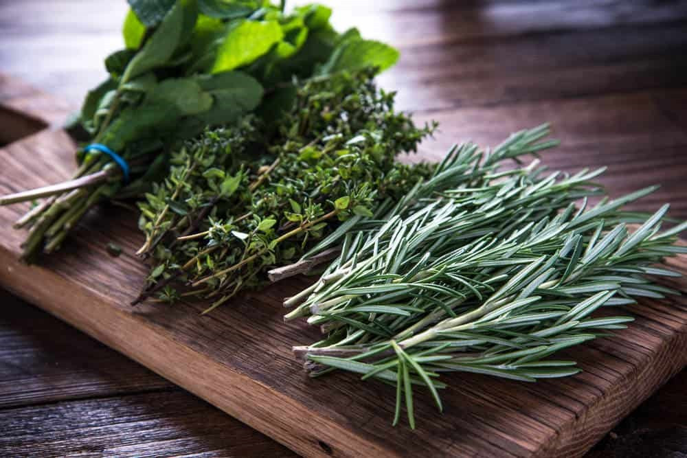 bunches of herbs on cutting board