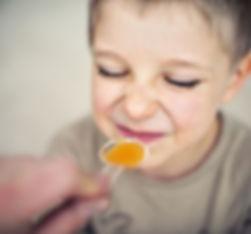 kid wrinkling nose at taking medication