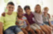 5 kids embracing and smiling